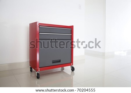 Metal solid red tool box on white background - stock photo
