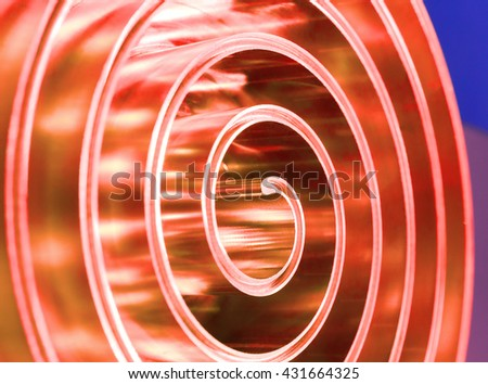 Metal spiral polished. Abstract background. Shallow depth of field. - stock photo