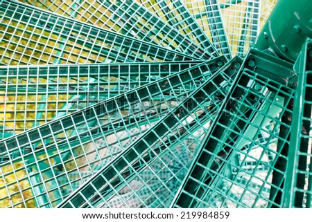 Metal spiral staircase built green. - stock photo