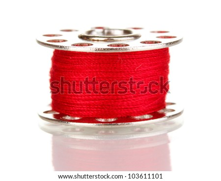 Metal spool of thread isolated on white
