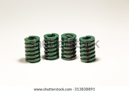 Metal spring isolated on white background. - stock photo