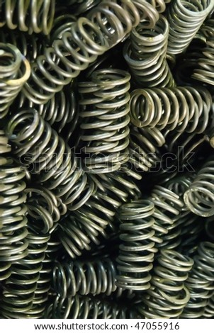 Metal springs at airplane jet engine factory - stock photo