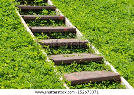 metal stair on green field - stock photo