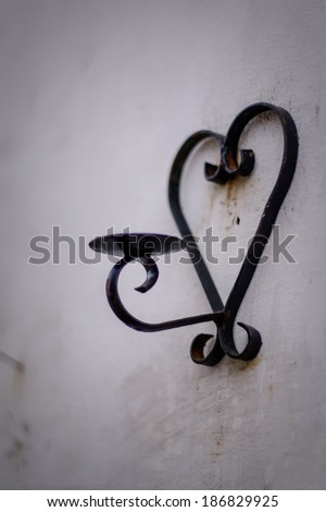 Metal stand for candle hanging on a wall - stock photo