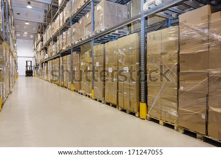 Metal stillage in a warehouse with cartons - stock photo