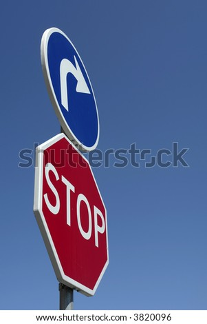 metal stop sign close up with the sky as background - stock photo