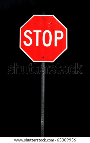 Metal stop sign during the night time - stock photo