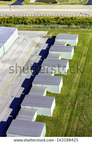 Metal storage garage with parking lot aerial view - stock photo