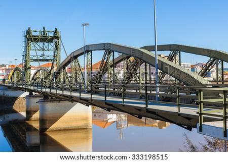 Metal structure elevation bridge over Sado river. Alcacer do Sal, Portugal - stock photo