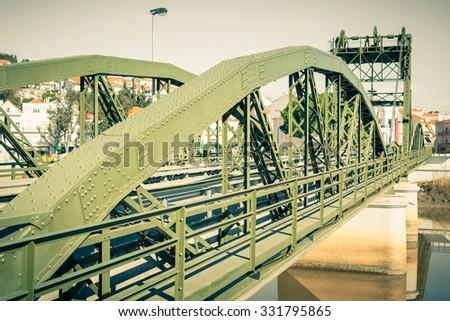 Metal structure elevation bridge over Sado river. Alcacer do Sal, Portugal. Filtered shot - stock photo