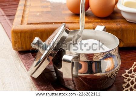 metal sugar bowl with teaspoon - stock photo