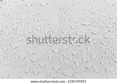 Metal surface covered in water drops bottom, closeup.  - stock photo