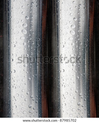 Metal surface of stainless steel beads/water drops - stock photo