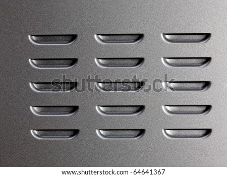 Metal surface with air vent perforation. - stock photo