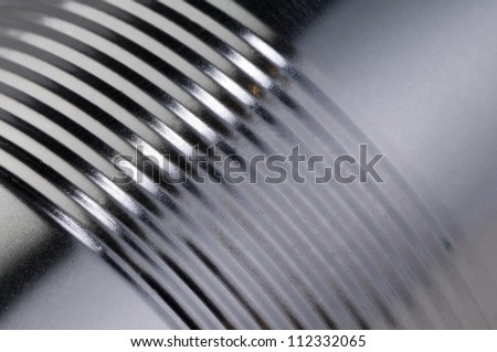 metal surface with embossed strips close-up abstract background - stock photo