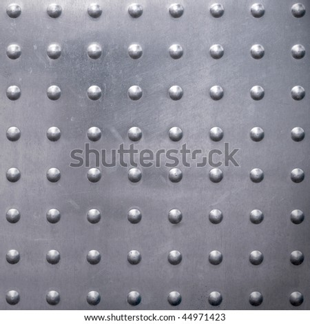 Metal surface  with rivets as a background motive - stock photo