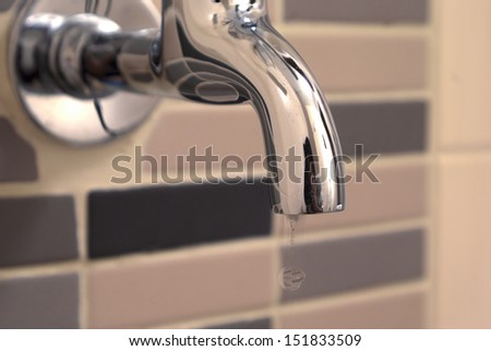 metal tap with water drop - stock photo