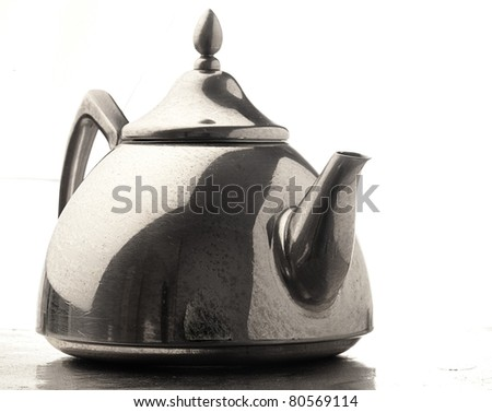 metal tea pot on a white background - stock photo