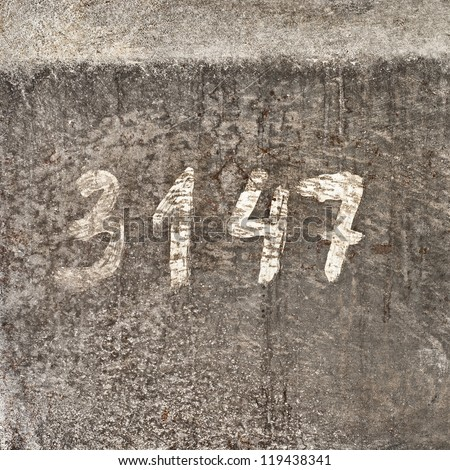 Metal  texture background with painted number, mill room