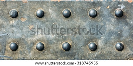 Metal Texture. Grunge background metal plate with screws - stock photo