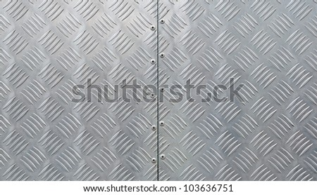 metal texture, shiny aluminum background with diagonal relief part - stock photo
