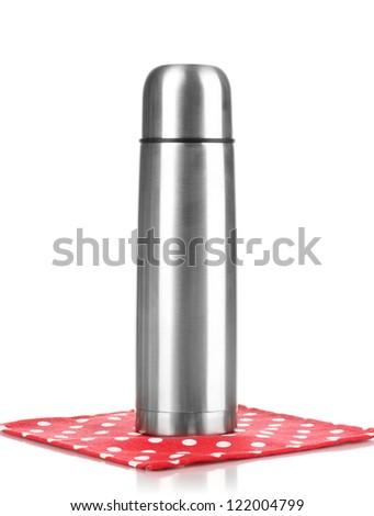 metal thermos on napkin isolated on white - stock photo