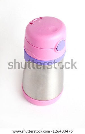 Metal thermos with pink cap - stock photo