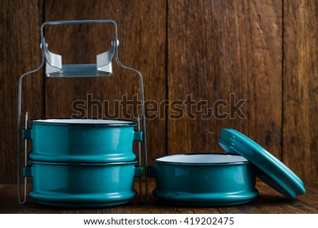 Metal tiffin, Thai food carrier on wooden background.