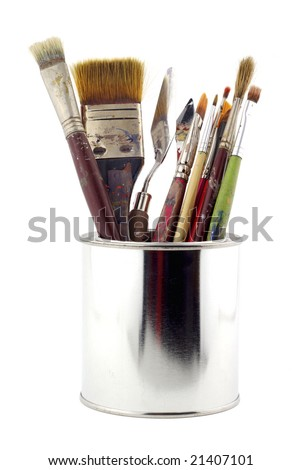 Metal tin with painter's brushes - stock photo