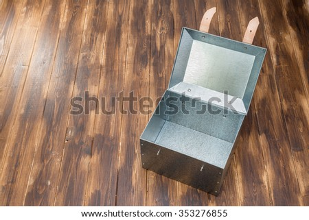 metal tool box on wooden table, Studio Shot - stock photo