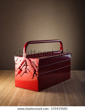 Metal toolbox on wooden table - stock photo