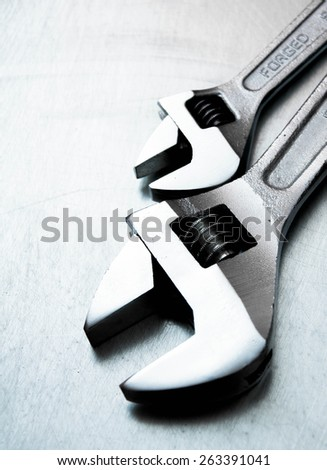 Metal tools. Metal style. Wrench on the scratched metal background. - stock photo