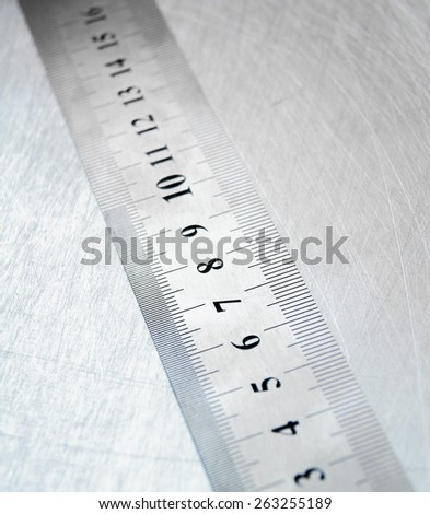 Metal tools. Ruler on the scratched metal background. - stock photo
