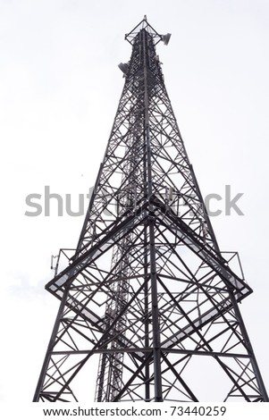 Metal tower with various communication antennas isolated on white. - stock photo