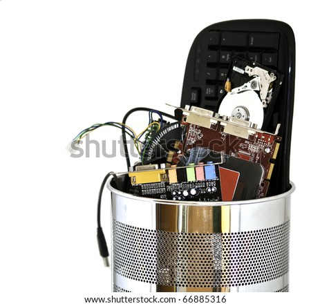 Metal trash can containing computer waste isolated on white background