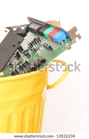 Metal trash can containing electronic and computing waste - stock photo