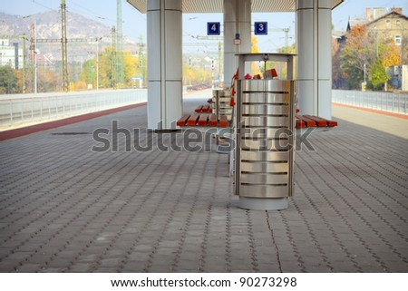 Metal trash can on a railway station