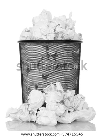 Metal trash can overflowing with paper waste isolated on white background. - stock photo