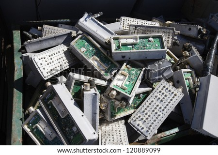Metal trash can with electronic and computing waste - stock photo