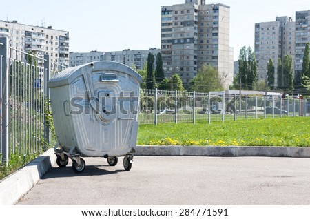 Metal trash container - stock photo
