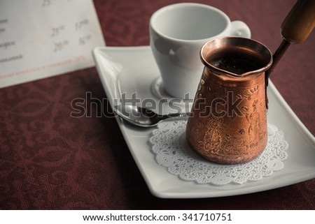Metal turk and coffee cup - stock photo