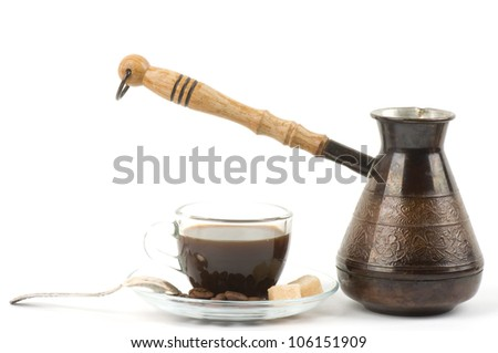 Metal turk and coffee cup isolated on a white background