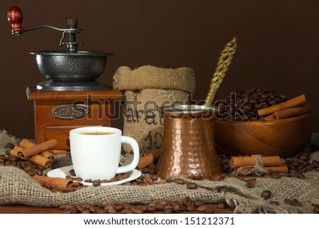 Metal turk and coffee cup on dark background