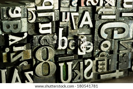 Metal Type Printing Press Typeset Obsolete Typography Text Letters Sign - stock photo