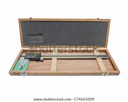 Metal vernier caliper in wooden box package isolated on white background. - stock photo