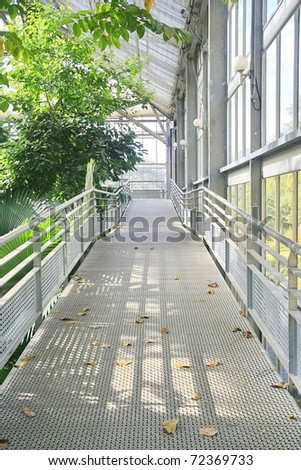 Metal walk way in conservatory - stock photo