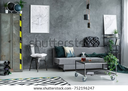 Metal Wardrobe In Grey Living Room Interior With Settee Against Dark  Concrete Wall With City Map