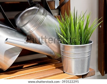 Metal Watering Can or Watering Pot with Green Plants, Watering Can Used to Water Plants by Hand. - stock photo