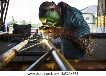 Metal welder Are connected together into larger pieces, sparking