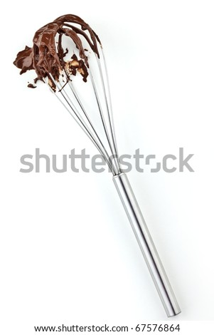 Metal whisk with chocolate isolated on white - stock photo